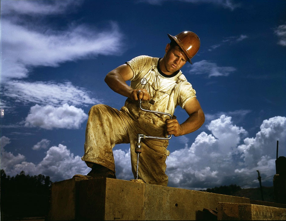 The Great Depression: A carpenter at the TVA's new Douglas dam on the French Broad River, Tenn.