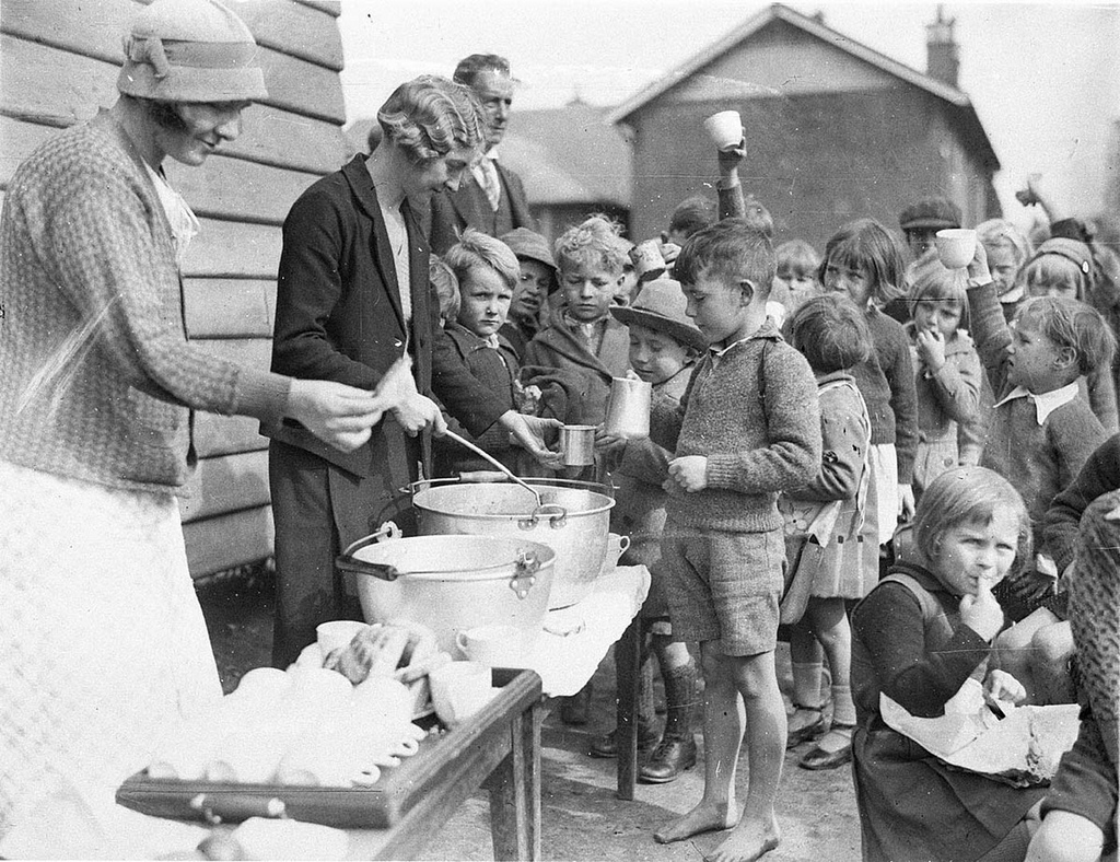 Schoolchildren line up for free issue of soup and a slice of bread in the Depression, Belmore North Public School, Sydney, 2 August 1934